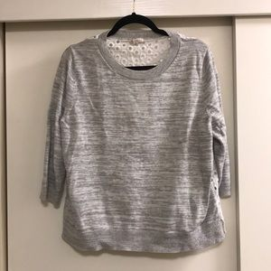 Marbled light gray sweater with a fun back!